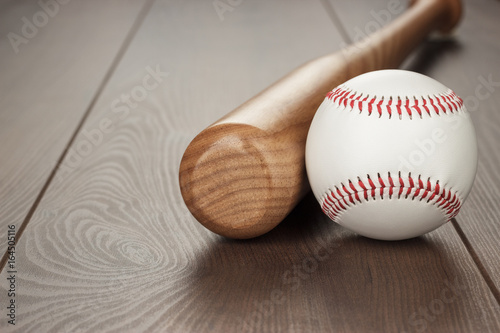 closeup of baseball bat and ball on wooden table with copy space Poster