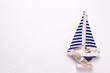 Decorative  wooden to  boat on textured  white  background.