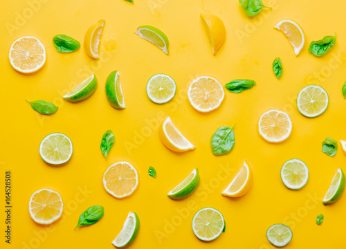 Above view at cutted lemons and limes with cucumbers