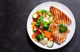plate of grilled chicken with vegetables - 164547570