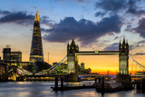 Tower Bridge, the Shard, city hall and business district in the background at night, London, Uk. - 164553333