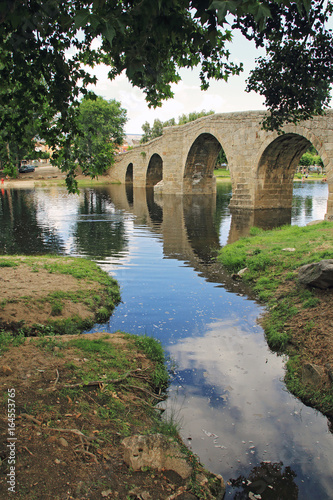 Countryside, ancient bridge and river