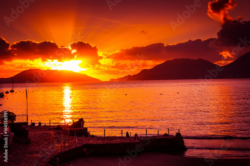 Foto op Plexiglas Oranje eclat Beautiful scenic sea sunset in Lerici, Liguria, Italy.