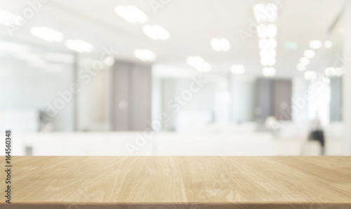 Wood table top and blurred bokeh office interior space background - can used for display or montage your products.
