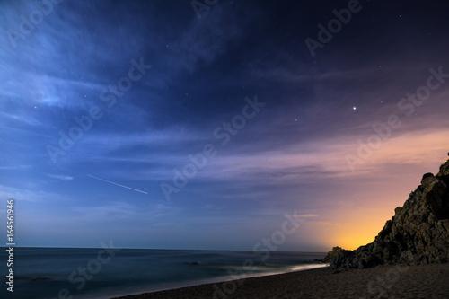 Night sky over the coastline