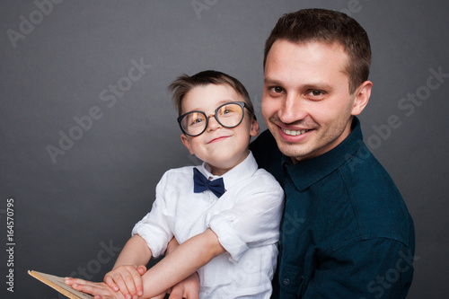 Smiling man with kid and book Poster