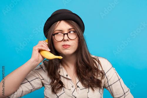 Woman using banana as phone