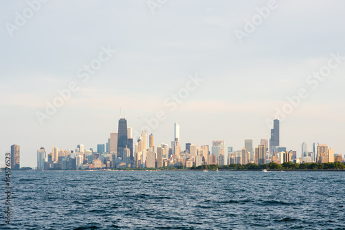 Hazy view of the Chicago skyline with Lake Michigan in the foreground
