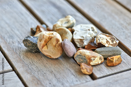Lot of little rocks on wooden table