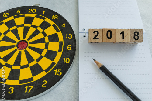 Poster 2018 goals and target concept with wooden blocks number and dartboard with note
