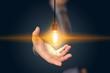 businessman holding light bulb. creative business strategy concept