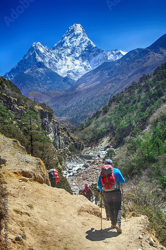 Goup of climbers in action, view on the Himalayas peak Ama Dablam, Nepal Poster