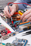 Engineer checking motherboard with multimeter - 164599964
