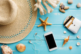 Seashells on blue wood, online shopping on smartphone - 164601568