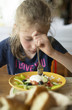 Little girl don't want to eat meal in restaurant. - 164632315