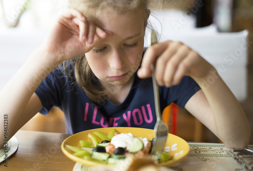 Little girl don't want to eat meal in restaurant. - 164632383
