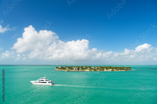 touristic yachts floating by green island at Key West, Florida