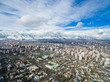 Aerial drone shot of Santiago de Chile at winter. Snowy cityscape of the city - 164643167
