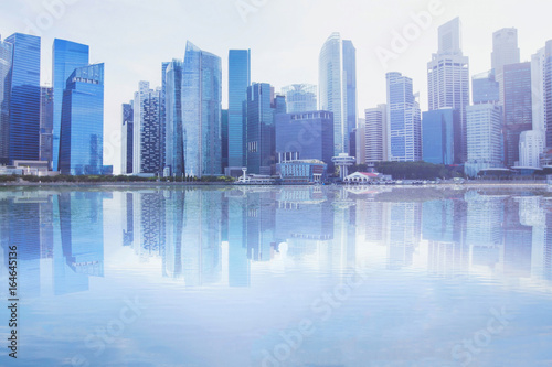 modern cityscape skyline with reflection in the water, business office buildings Poster