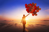 inspiration, joy and happiness concept, silhouette of woman with many flying balloons on the beach - 164645303
