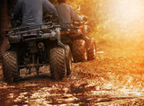 Fototapety man riding atv vehicle on off road track ,people outdoor sport activitiies theme