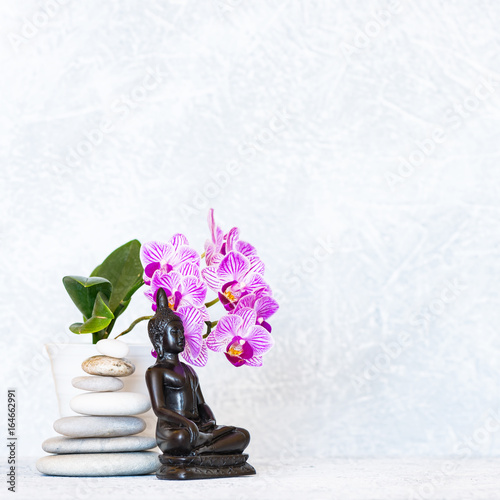 Foto op Canvas Zen Buddha, pyramid of pebbles and orchid flower as zen background