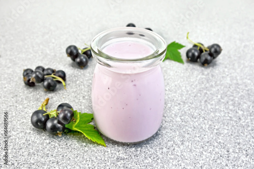 Milk cocktail with black currant on granite table
