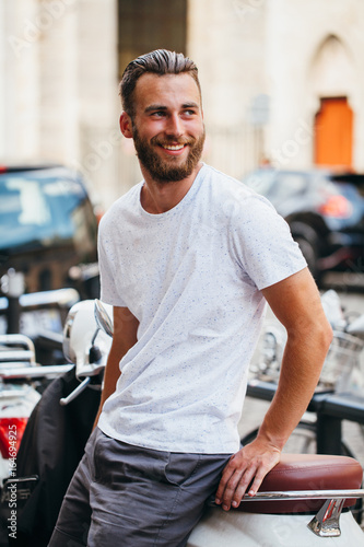 82b623c20d8f Hipster handsome male model with beard wearing white blank t-shirt with  space for your