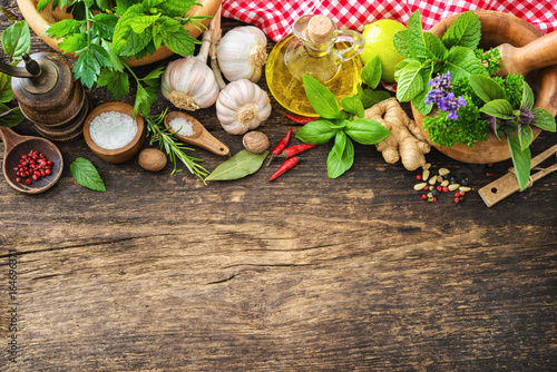 Fresh herbs and spices on wooden table - 164696371
