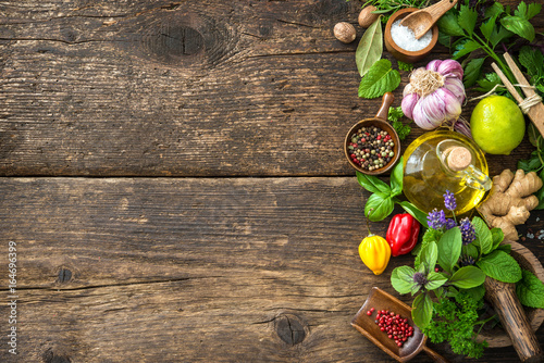 Fresh herbs and spices on wooden table - 164696399