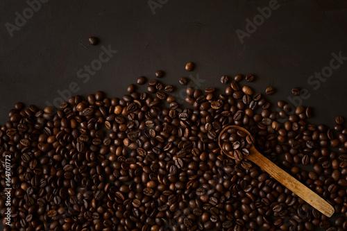 Fotobehang Koffiebonen Coffee beans on dark wooden background
