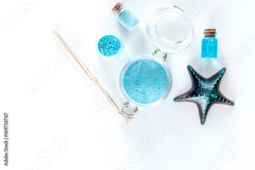 Sea cosmetics. Sea salt, blue clay and lotion on white background top view copyspace