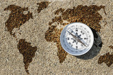 Compass and world map on small gravel stone, Find the right way for our earth concept
