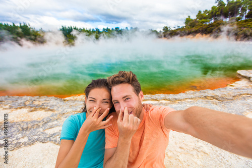 Funny selfie couple tourists at New Zealand pools travel Poster