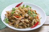 Spicy Fried Bamboo Shoot on Wooden table.