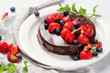 Chocolate cake with berries - 164797980