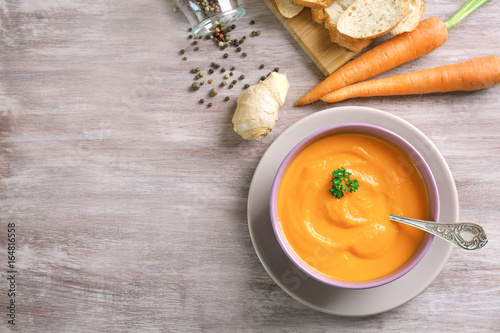 Fotobehang Kruiden 2 Composition with delicious carrot soup and fresh ginger on wooden table
