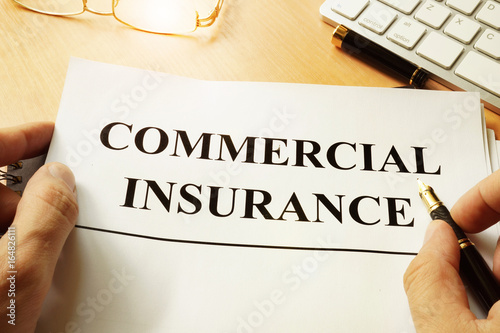 Commercial insurance form on a table.