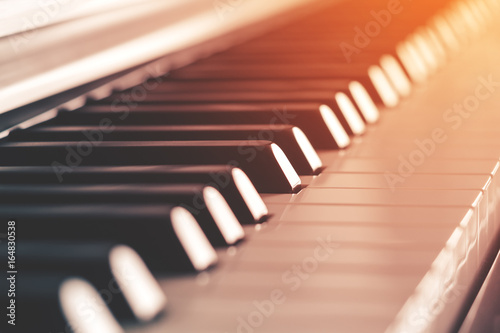Piano keys side view with warm light (toned) - 164830538