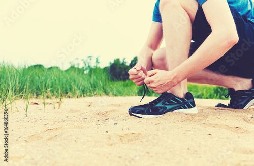Runner preparing to go for a jog outdoors