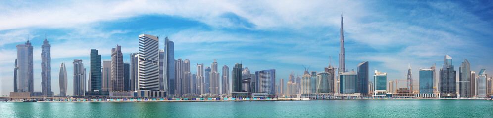 DUBAI, UAE - MARCH 29, 2017: The panorama with the new Canal and skyscrapers of Downtown.