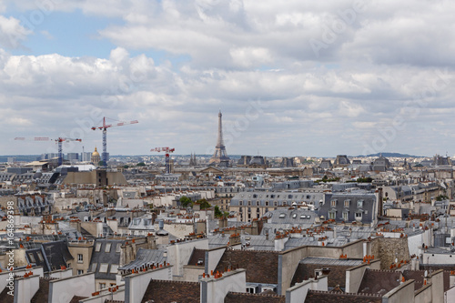 cityscape of Paris at cloudy summer day