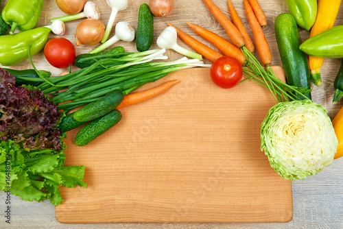 closeup of fresh fruits and vegetables on wooden table, healthy food concept, abstract object and background - 164881762