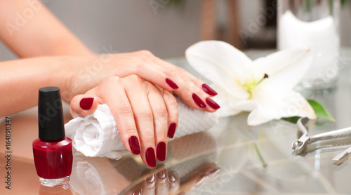 Manicure concept. Beautiful woman's hands with perfect manicure at  beauty salon. - 164898347