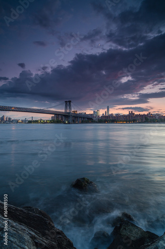 Sunset view on Manhattan from the rock beach Poster