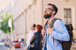 Urban traveller bearded man with a backpack. - 164920710