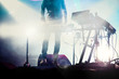 disc jokey mixing on stage over illuminated smoke background - summer music festival