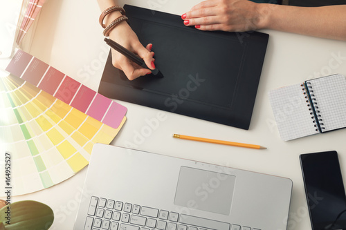graphic designer using digital drawing tablet at office. top view Poster