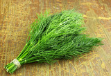 bunch of dill on wooden background - 164955569