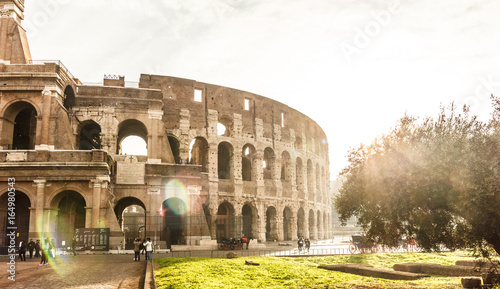 Famous landmark Colosseum in vintage style and sunlight effect.